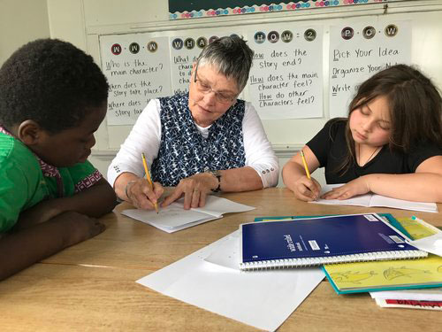 Volunteer With Children in Tutoring Session - Read and Write Kalamazoo